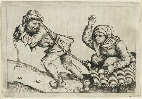 Un homme trainant sa femme dans un panier