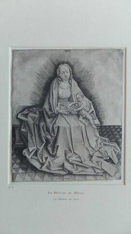 La Vierge avec l'enfant Jésus qui tourne le feuillet d'un livre