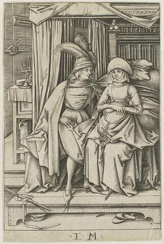 Homme et femme assis sur un lit
