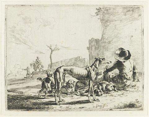 L'homme et ses quatre chiens