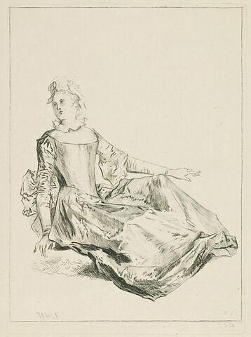 Jeune femme assise par terre