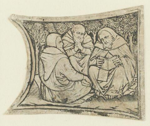 Trois moines accroupis