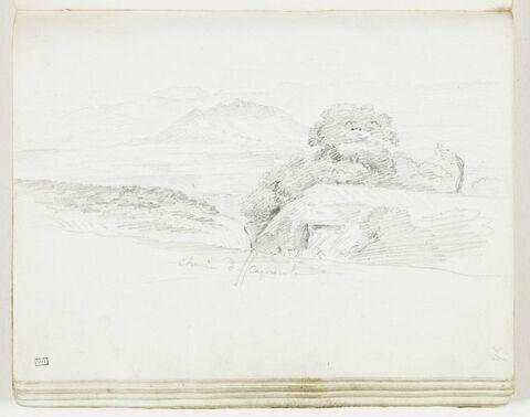 Vallée coupée par un chemin où s'engagent des cavaliers, avec, dans le fond, le mont Soracte
